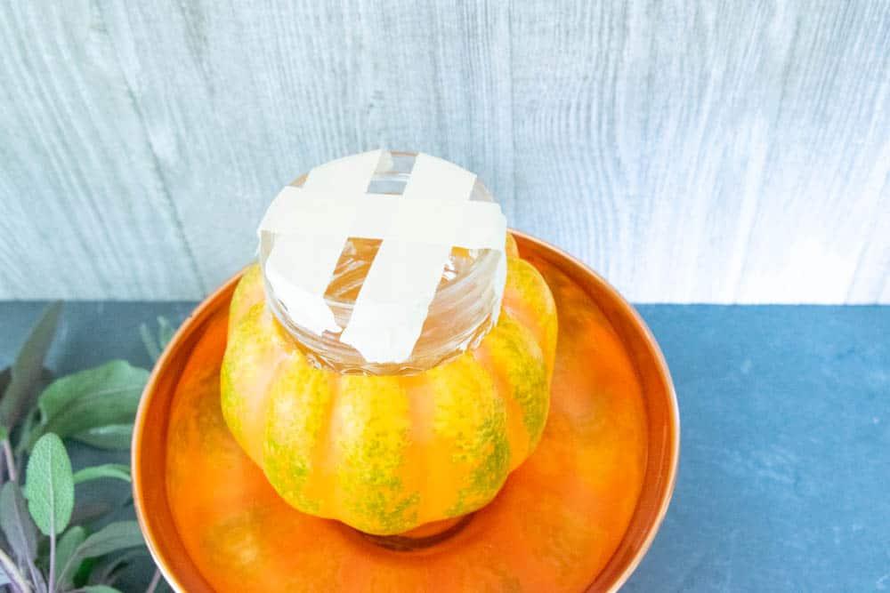 pumpkin,glass jar with masking tape