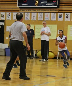 A student gets ready to pass the ball to a teammate