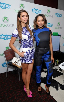 SAN DIEGO, CA - JULY 26: 'The Vampire Diaries' actresses Nina Dobrev (L) and Kat Graham chat with fans over Skype for Xbox One in the Microsoft VIP Lounge during Comic-Con on July 26, 2014 in San Diego, California. (Photo by John Sciulli/Getty Images for Xbox)
