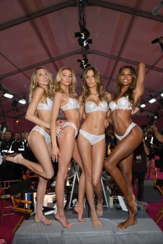 Martha Hunt, Stella Maxwell,Josephine Skriver and Jasmine Tookes pose prior the 2016 Victoria's Secret Fashion Show on November 30, 2016 in Paris, France.