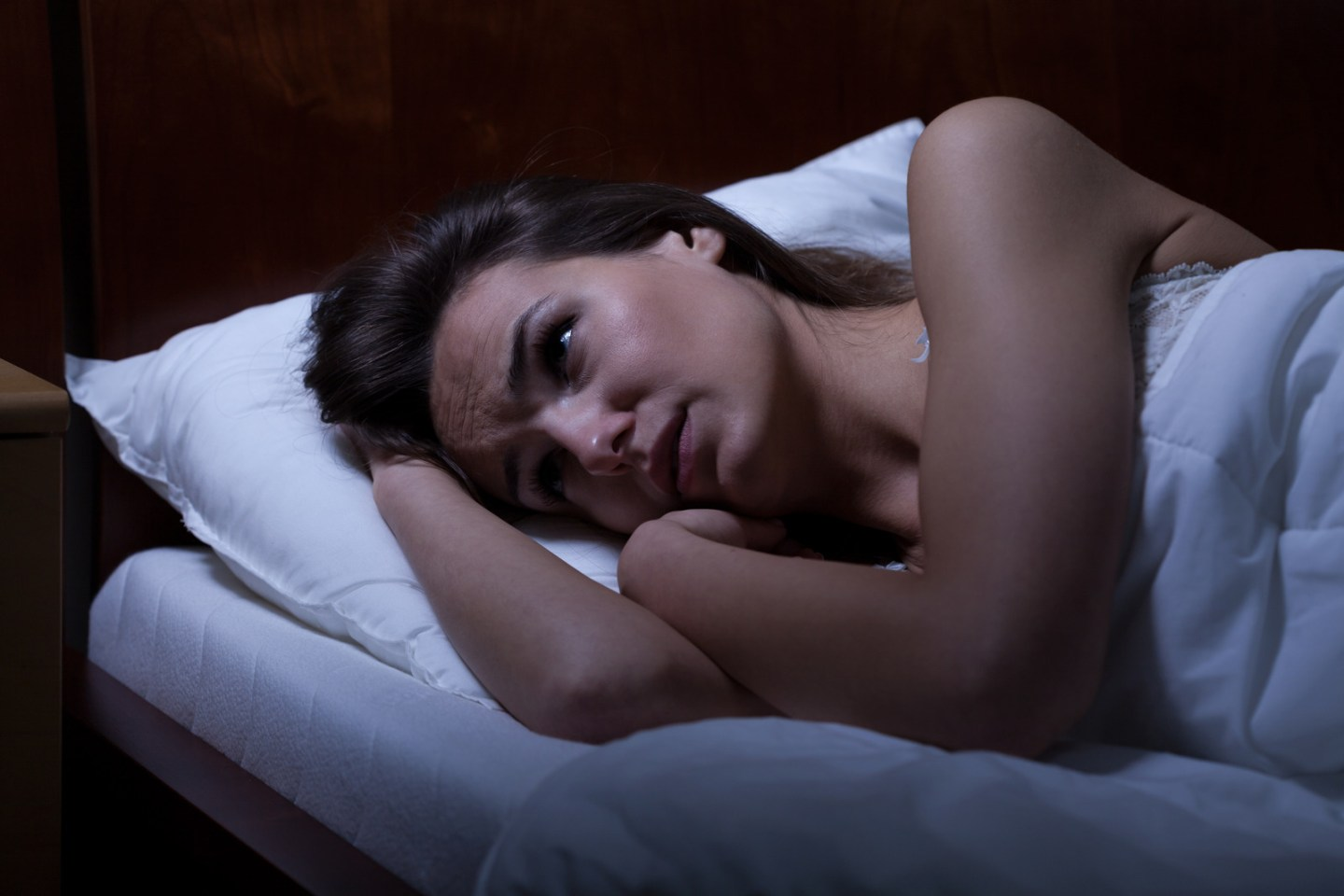View of woman can't sleep during night