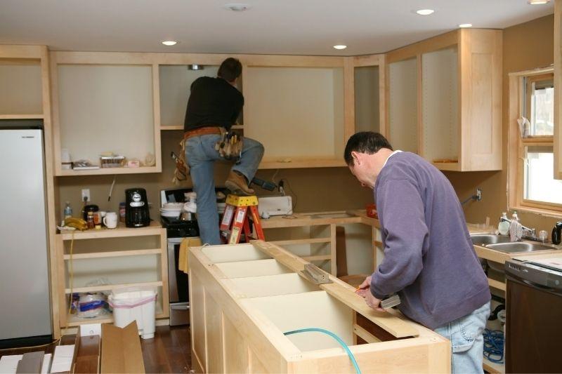 Professionals renovating a kitchen