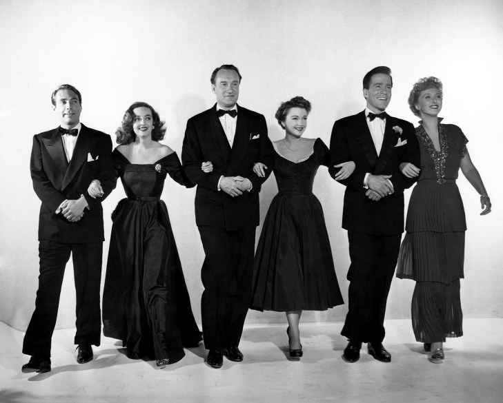 "A publicity still from the 1950 Academy Award®-winning drama ""All about Eve"" features (left to right): Gary Merrill, Bette Davis, George Sanders, Anne Baxter, Hugh Marlowe and Celeste Holm. ""All about Eve"" received a record 14 Academy Award nominations and won six Oscars®, including Best Picture. Restored by Nick & jane for Dr. Macro's High Quality Movie Scans Website: http:www.doctormacro.com. Enjoy!"