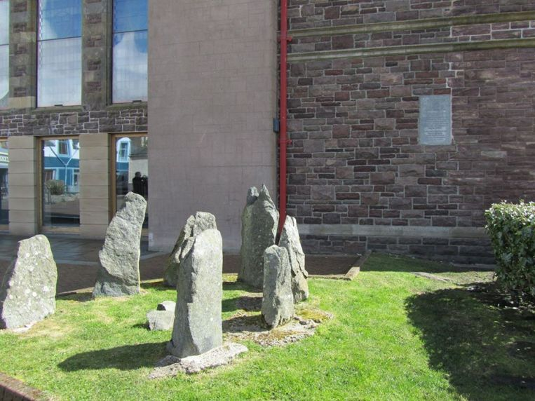Model stone circle on the site of Mackenzie's birthplace & memorial plaque behind
