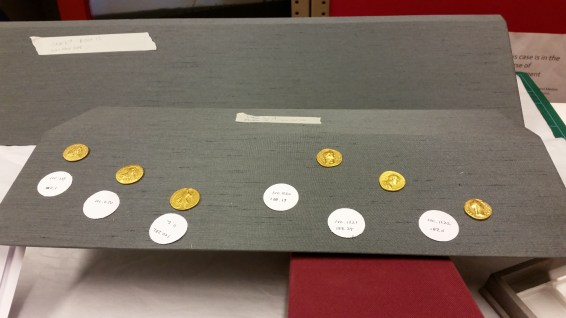 Placing and pinning the gold coins next to the amulet reliquary