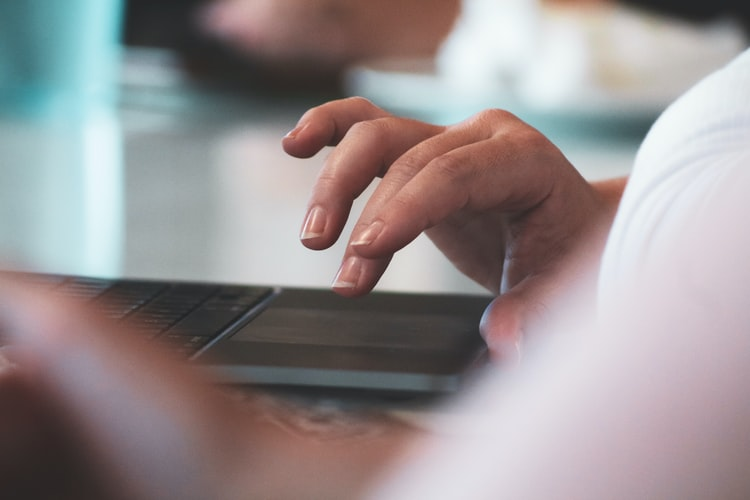 a hand using a laptop