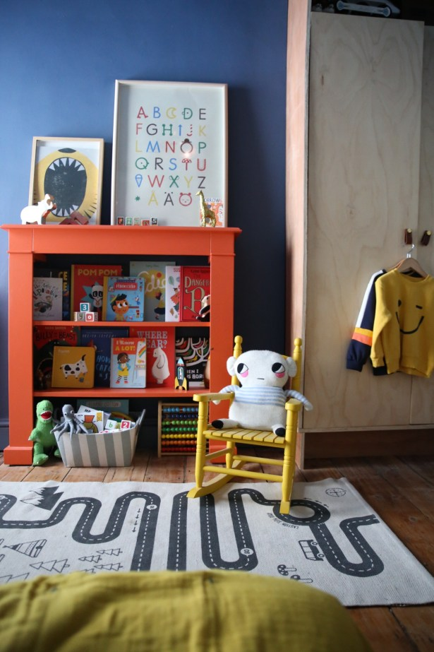 Unisex children's room design using bold colours.