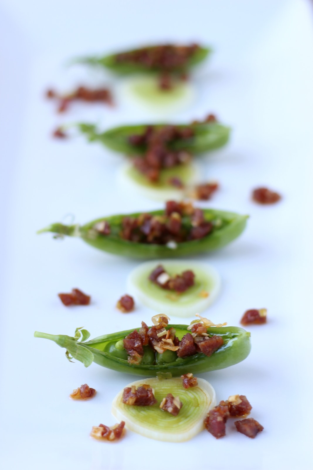 Chorizo and Leek Stuffed Pea Pods - thewoodenskillet.com #appetizer #spanishchorizo