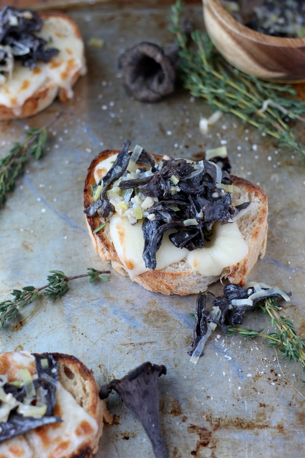 Creamy Leeks and Wild Black Trumpet Mushrooms on Toast. Perfect recipe for those fall mushrooms. Use as an appetizer, small plate or breakfast. thewoodenskillet.com #foodphotography #foodstyling