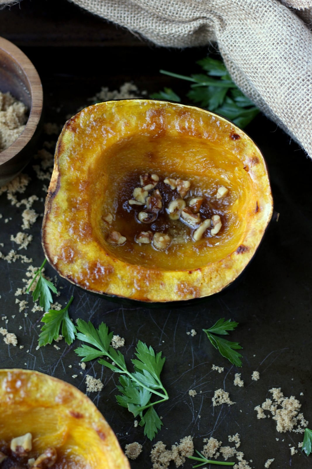 Roasted Acorn Squash with Walnuts, Browned Butter and Brown Sugar. The perfect fall side dish for any meal! thewoodenskillet.com #foodphotography #foodstyling