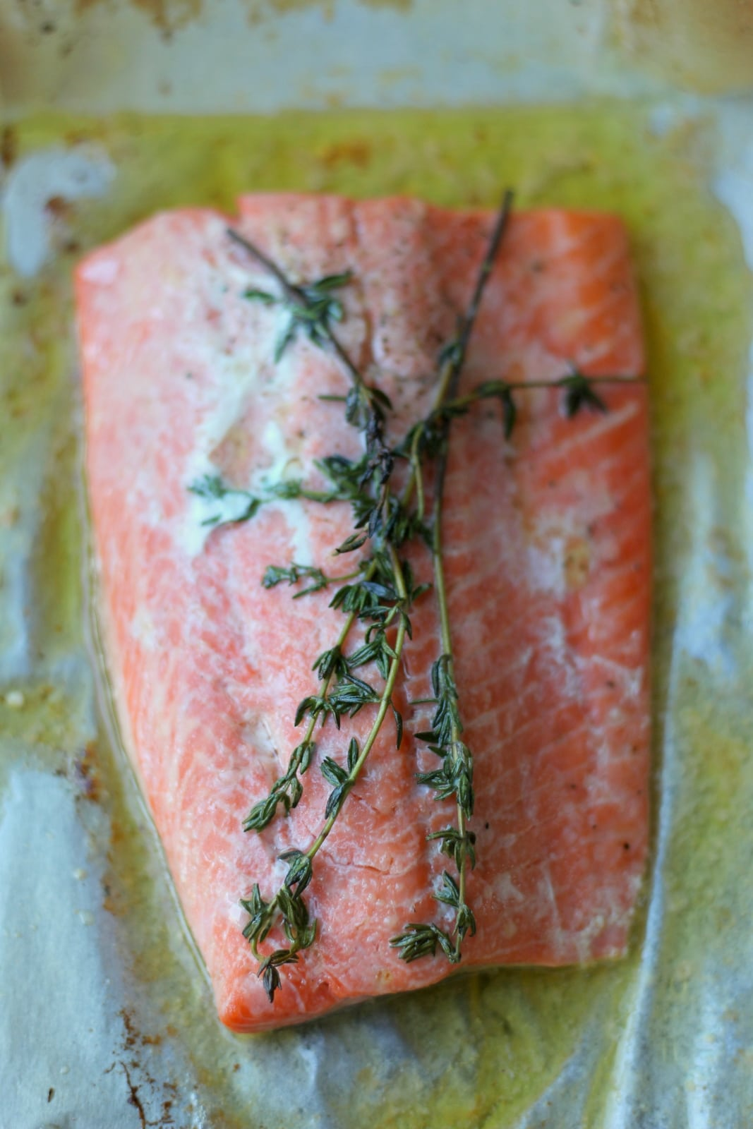 Simple Weeknight Salmon en Papillote. The best and easiest way to cook salmon! thewoodenskillet.com #foodphotography #foodstyling