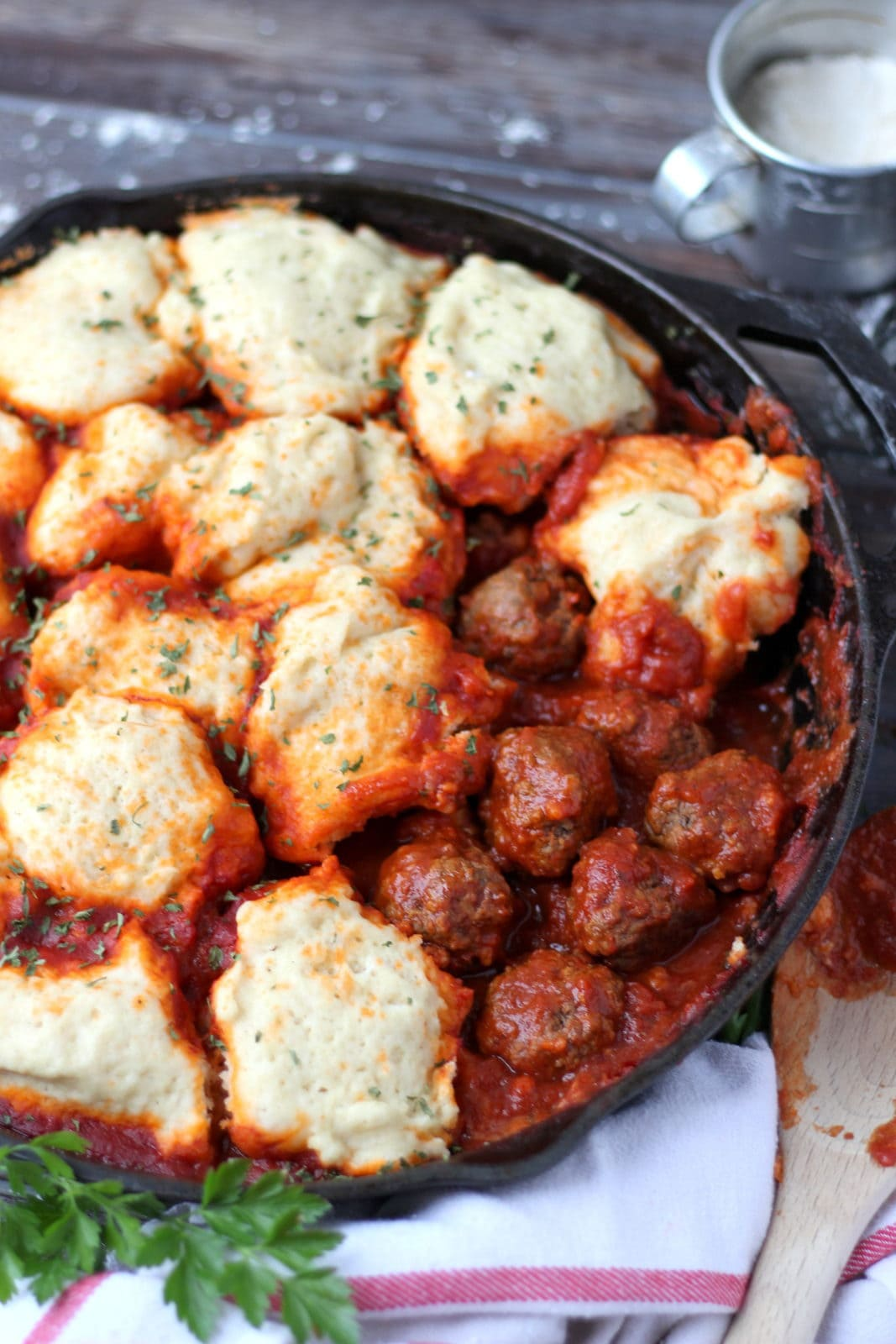 Meatballs and Dumplings - recipe for pillow soft dumplings served with meatballs simmered in tomato sauce. Perfect recipe for a weeknight meal! thewoodenskillet.com #foodphotography #foodstyling