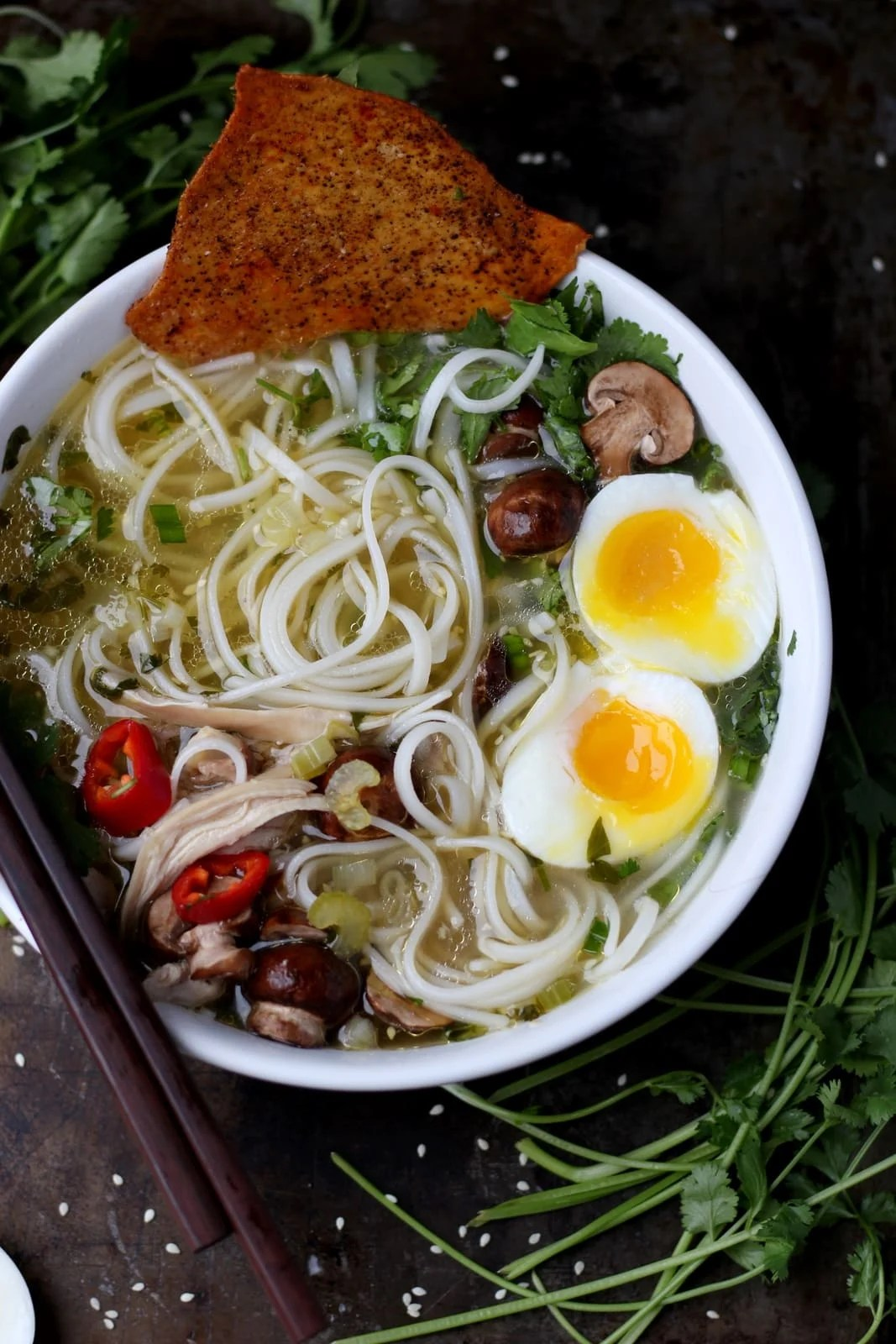 Chicken Ramen Noodle Soup + Crispy Chicken Skins - awesome recipe for ramen that uses rice noodles or ramen noodles. So savory and so many variations! thewoodenskillet.com #foodphotography #ramen