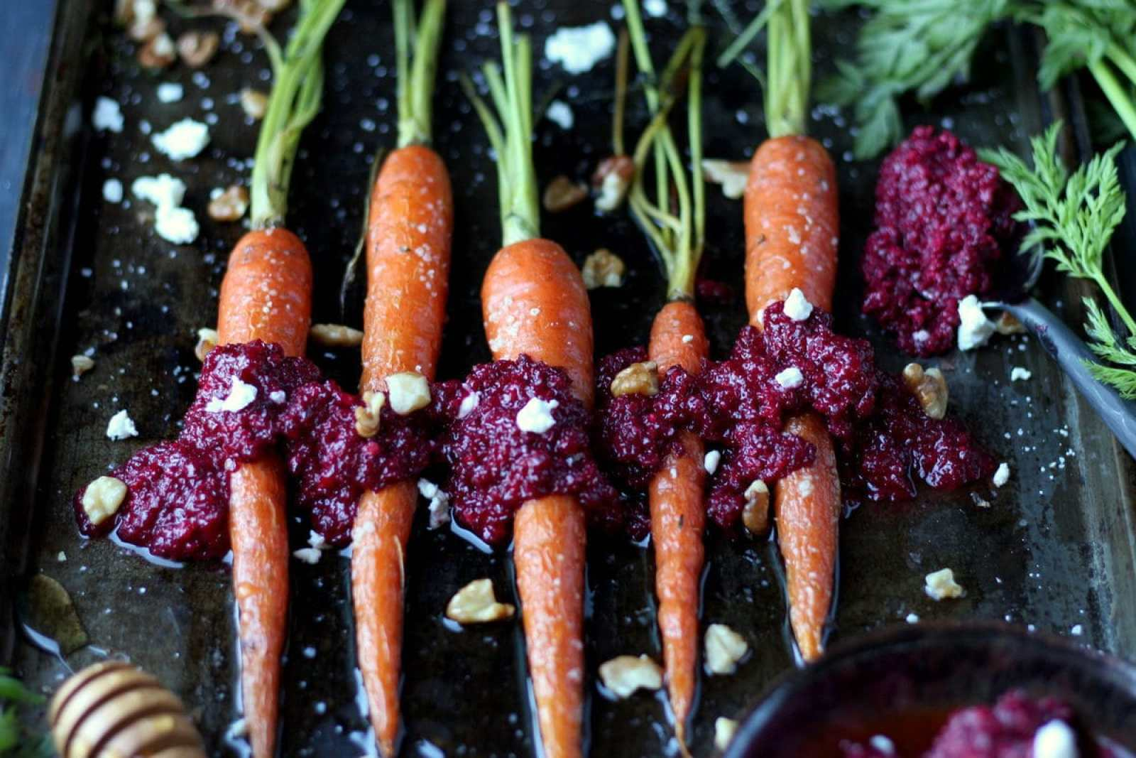 Whole Baked Carrots + Roasted Beet Pesto with Walnuts and Goat Cheese - perfect side dish for Thanksgiving or Christmas! thewoodenskillet.com #foodphotography #foodstyling