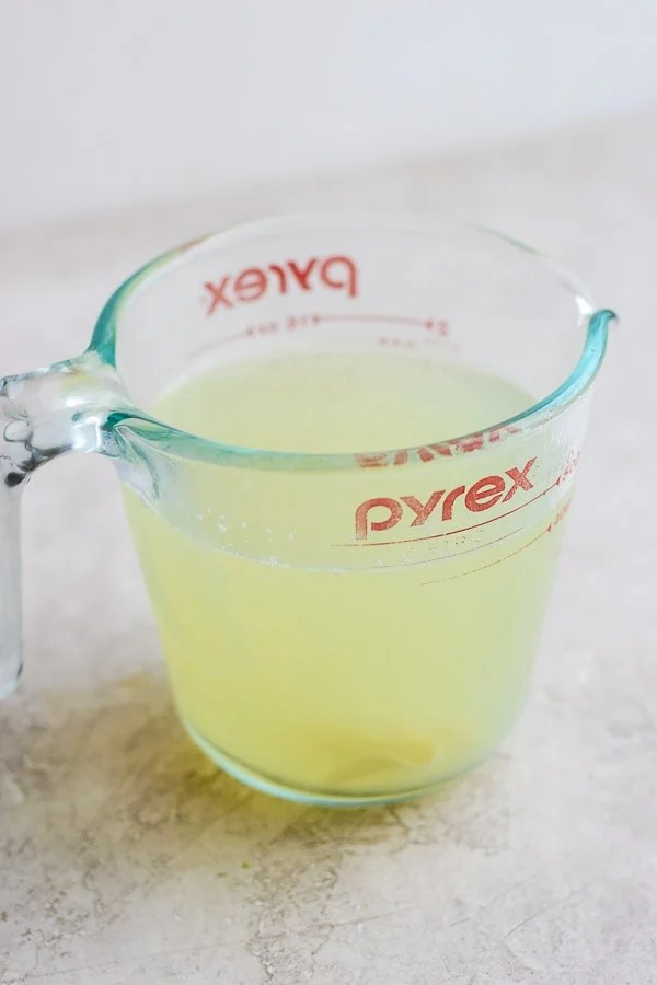 Glass pyrex measuring container full of pasta water.