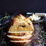 Cheesy Irish Soda Bread + Fresh Thyme and Rosemary. A cheesy twist on the classic Irish tradition - the perfect recipe for St. Patrick's Day! thewoodenskillet.com