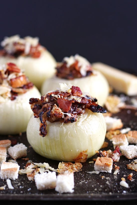 Stuffed Onions + Bacon and Gruyere Cheese. The perfect side dish recipe to elevate your next meal! thewoodenskillet.com