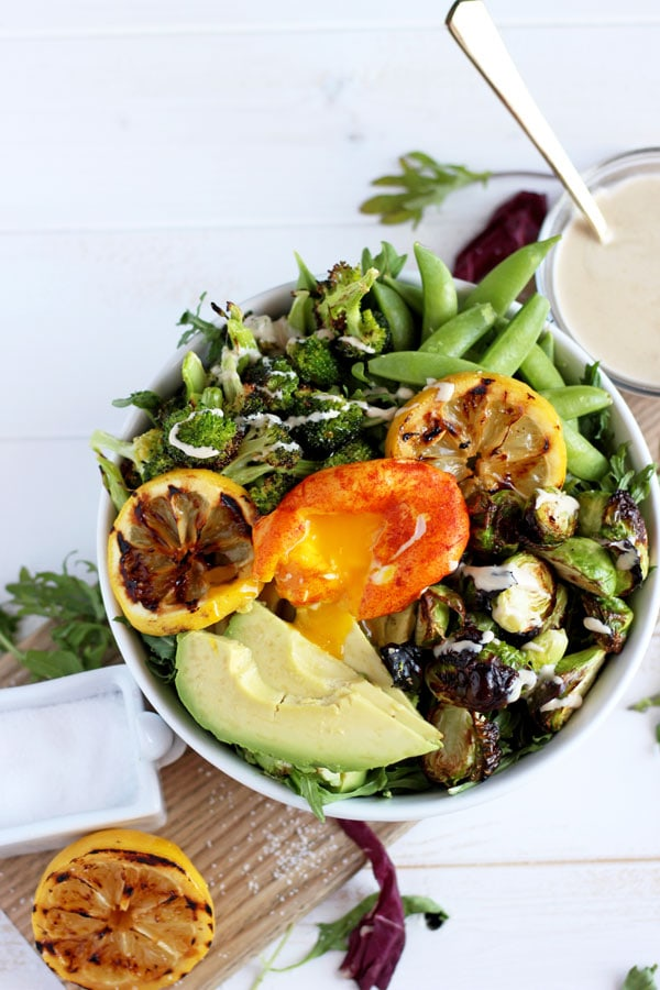 Healthy Spring Green Salad + Turmeric Egg. The perfect vegetarian salad that works for lunch or dinner!! thewoodenskillet.com