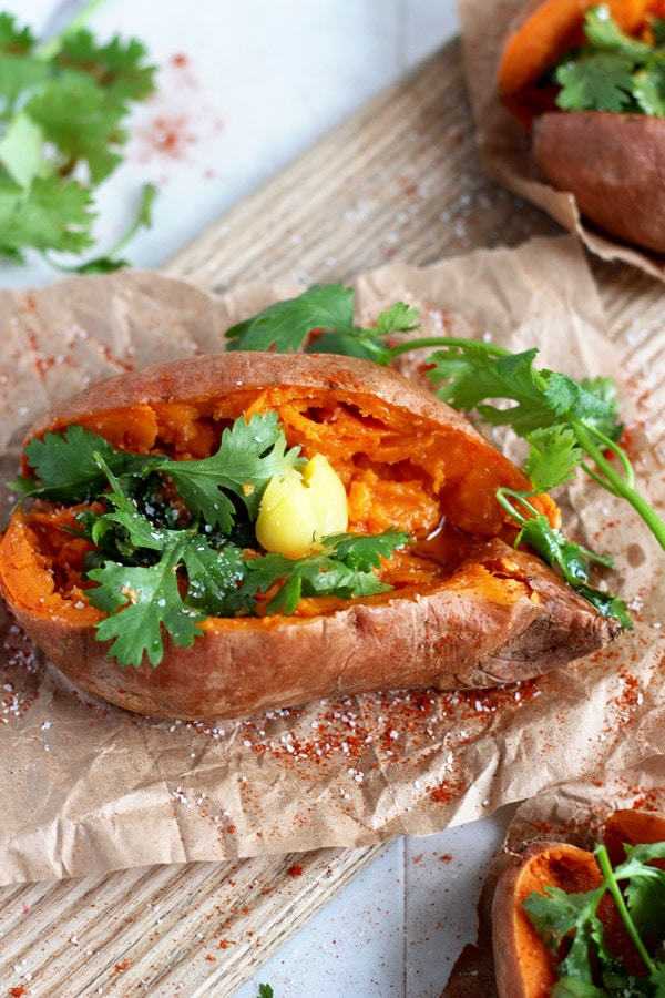 Ghee and Cilantro Stuffed Sweet Potato - a quick and healthy snack or side dish - whole30 compliant! thewoodenskillet..com