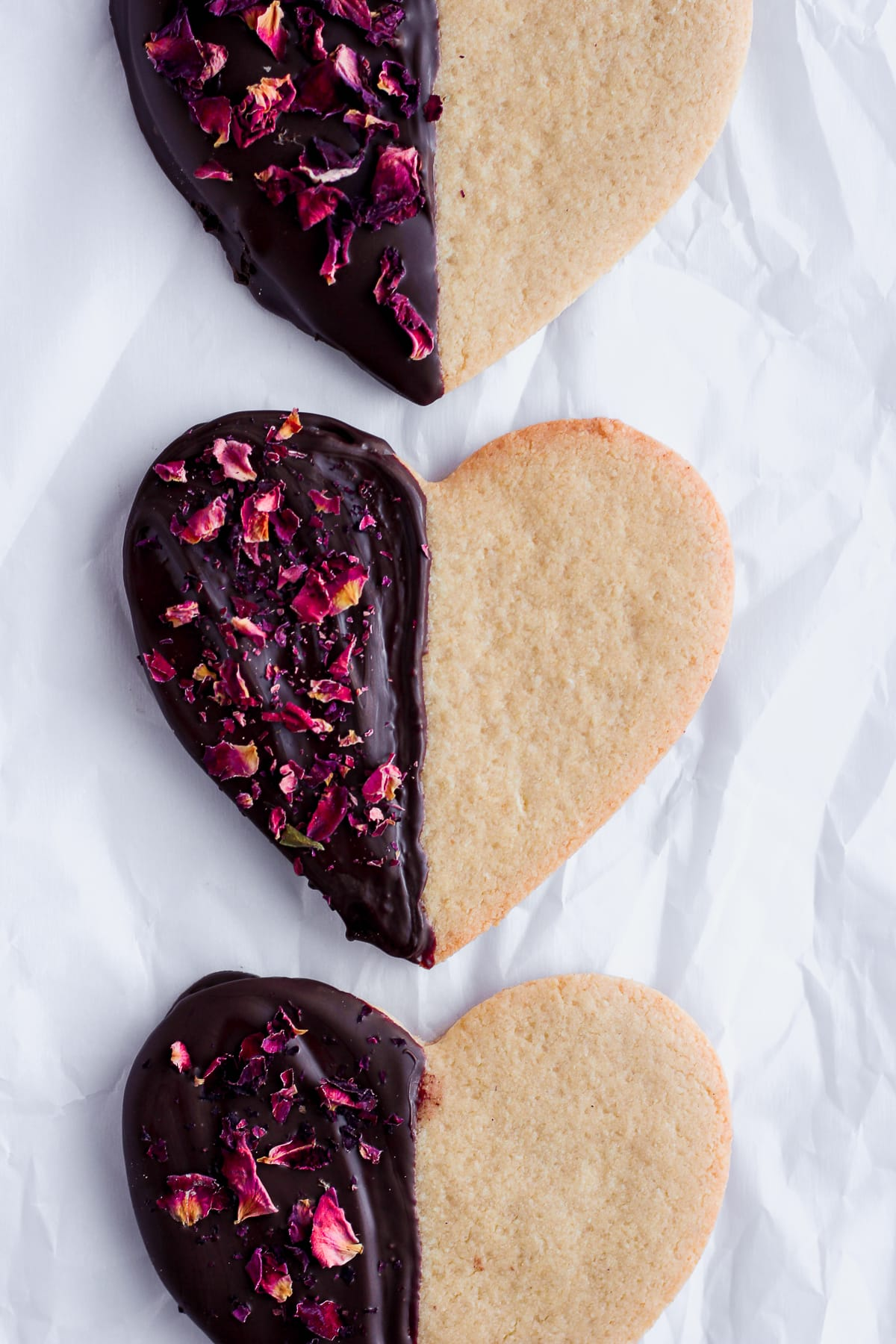 The Best Paleo Sugar Cookies, dipped in chocolate and sprinkled with roses, perfect for valentines day! #paleo #valentinesday