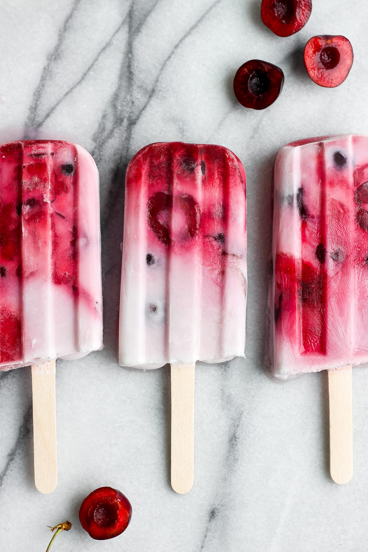 Healthy Strawberry Cherry and Cream Popsicles - a delicious summer treat that is vegan and dairy-free! #popsicles #vegan #dairyfree