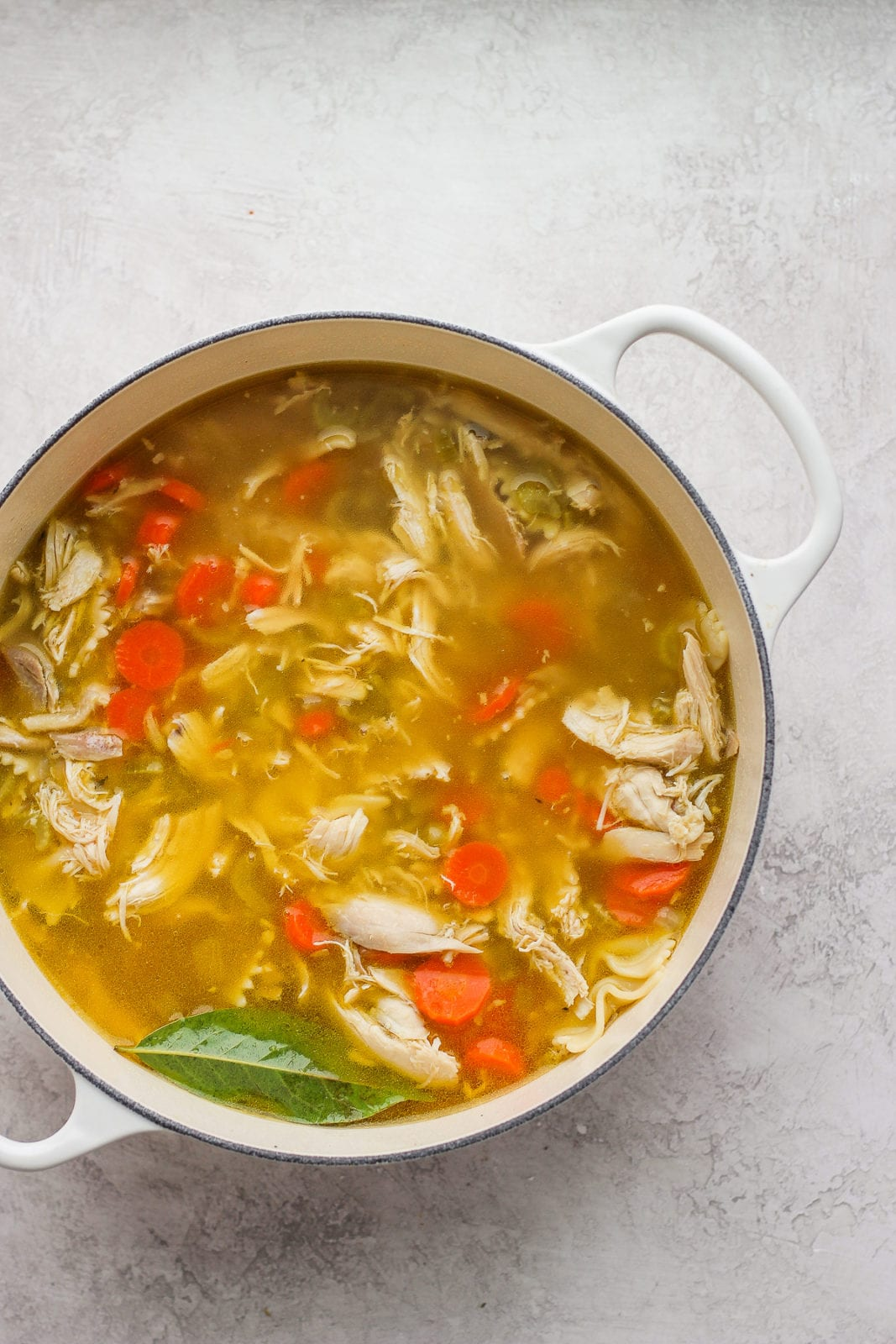 Sunday Afternoon Roasted Chicken Soup - roast your chicken first if you want to make the BEST homemade chicken soup EVER!! #homemadechickensoup #thebestchickensouprecipe #chickennoodlesoup #whole30soup #whole30recipes #paleorecipes #coldseason #wintersoup #coldremedies