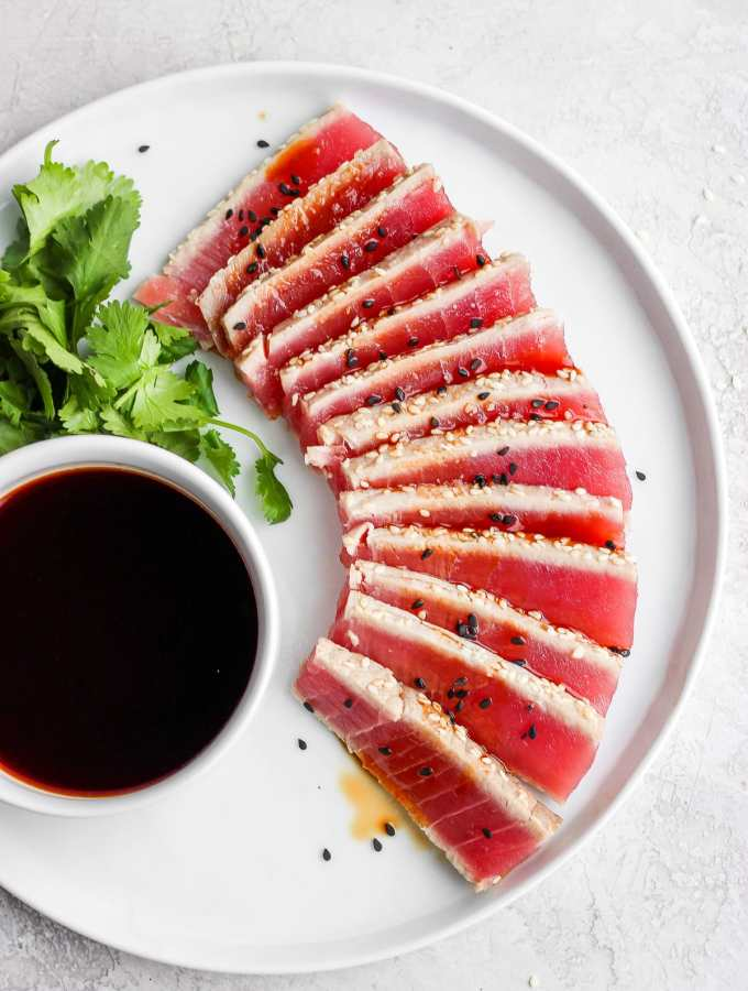 Simple Seared Ahi Tuna Recipe - all your seared ahi tuna questions answered PLUS a super simple recipes that is gluten-free, paleo and Whole30!! #whole30recipes #sushi #searedahitunarecipes #howtocooktuna #tunarecipes #tunasteak #paleorecipes #glutenfreerecipes #summerrecipes