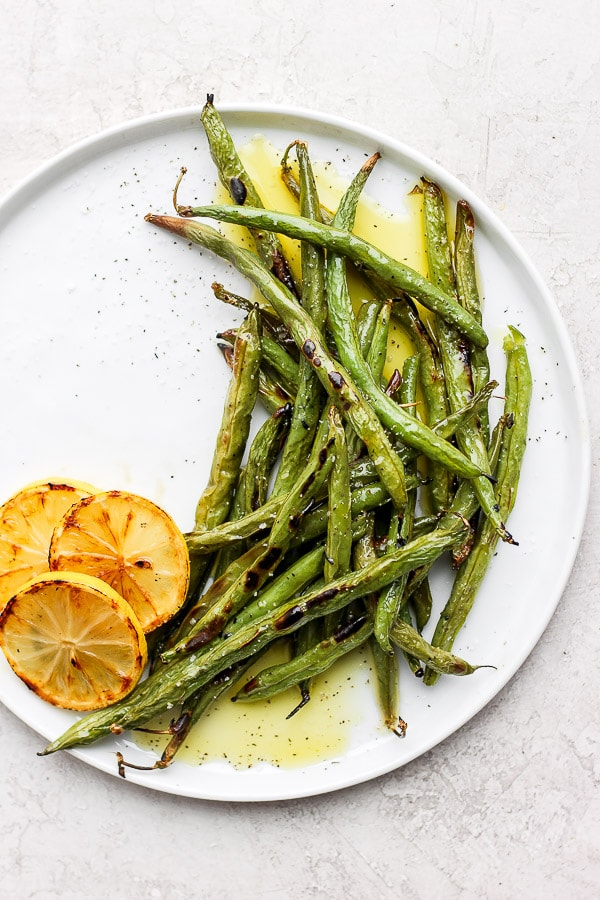 Easy Oven Roasted Green Beans - an easy and delicious side dish for any meal! (gluten-free, dairy-free) #ovenroastedgreenbeans #plantbased #dairyfreerecipes #glutenfreerecipes