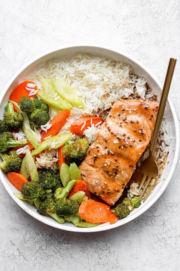 Bowl of teriyaki salmon with vegetables and jasmine rice.