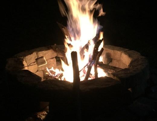 campfire roasting s'mores