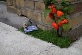 miniature picnic blanket by a brick wall