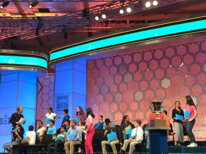 During commercial breaks, spellers got up, stretched, and talked amongst each other.
