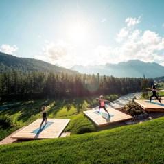 Grand Hotel Kronenhof - yoga class in progress on platforms