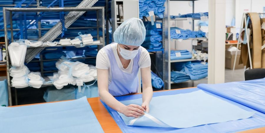 worker-in-a-face-mask-prepares-material-for-disposable-news-photo-1584975340