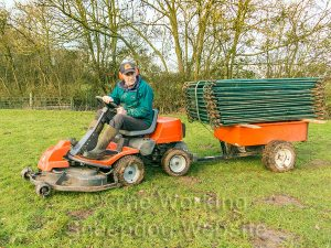 Ride-on 4x4 lawn mower for field work, moving hurdles.