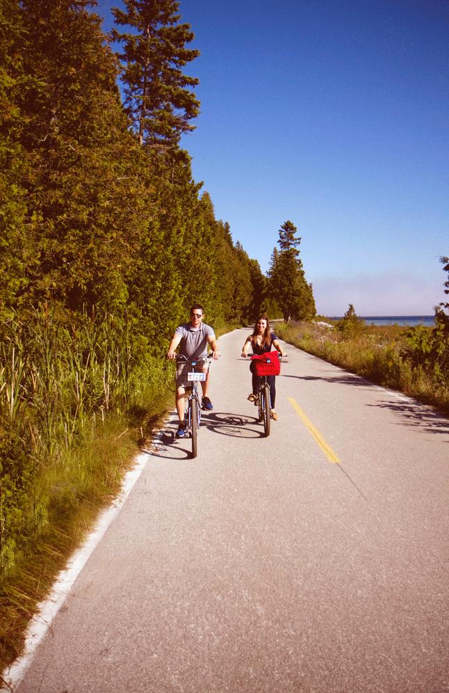 travel blogger Amanda biking around Mackinac Island, Michigan.