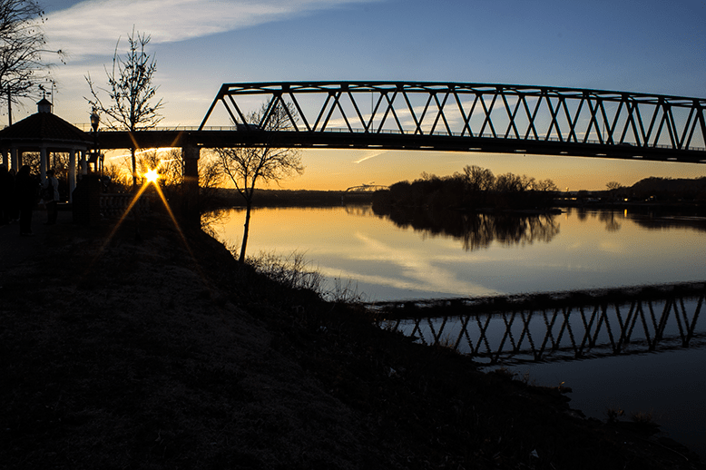 sunrise on the Ohio river in Marietta Ohio. Bridge silhouette