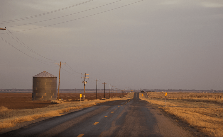 a country road in Texas at dusk.
