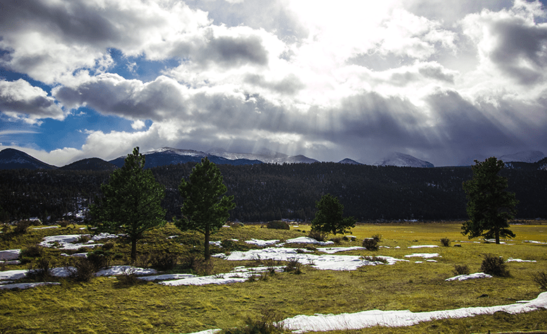 rays of sun shining down on Moraine Park in Rocky Mountain National Park, a stop on our Denver to Dallas road trip.