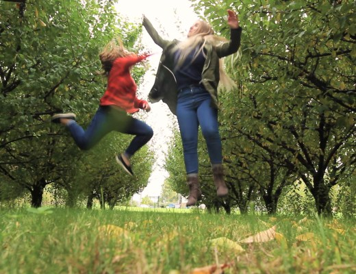 Michigan fall cider crawl! Two sisters try to visit as many Michigan cider mills as possible in one day. Jumping high five!