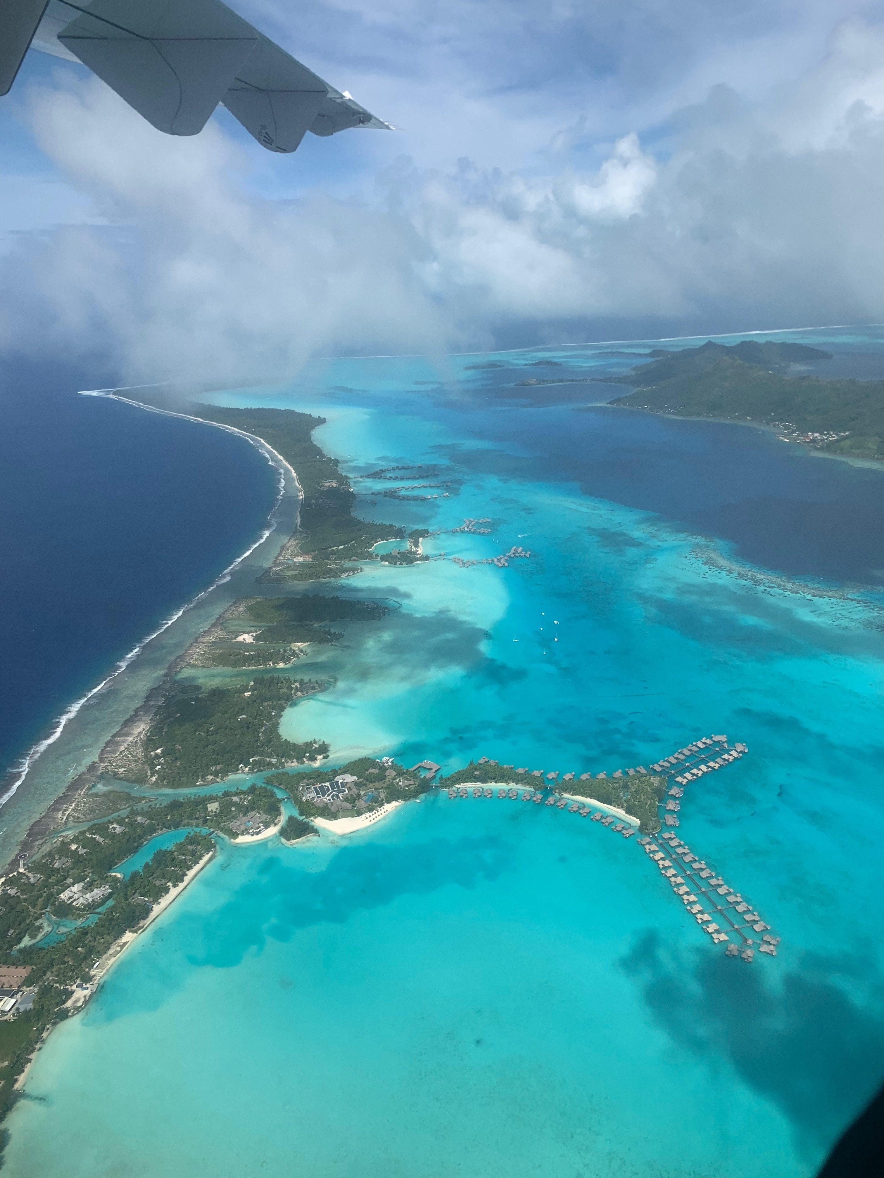 View of Bora Bora resorts from Air Tahiti plane