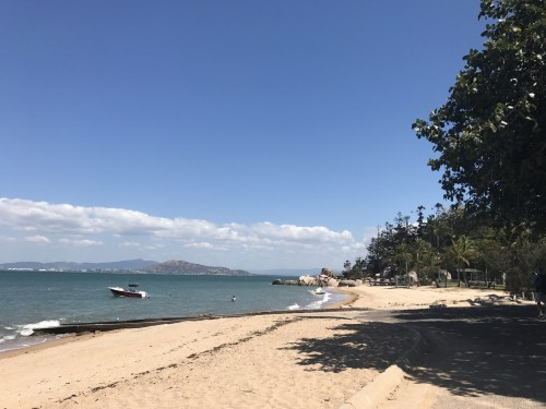 Picnic Bay. Beach on the right side of the jetty with views of Townsville
