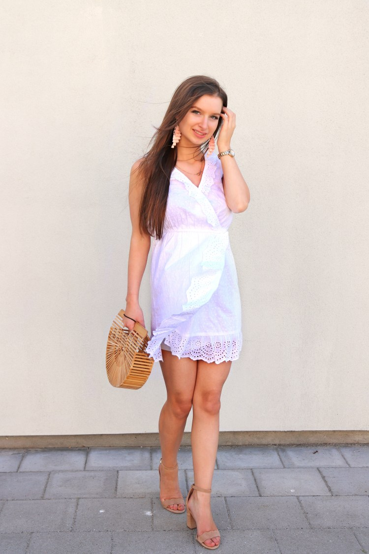 White dress cult gaia bag and statement earrings