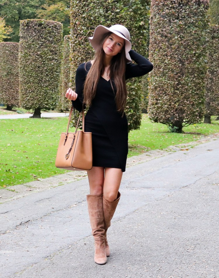 Little black dress with winter hat and cognac boots