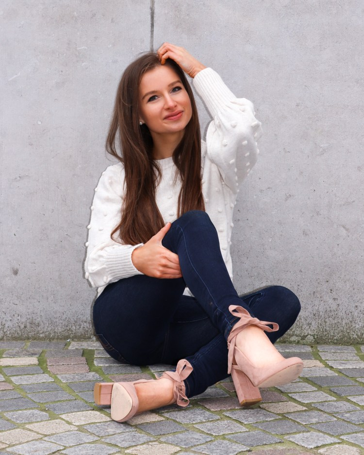 pink pumps and white sweater outfit