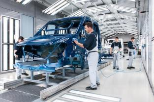 The Mercedes-Benz plant in Ludwigsfelde. Employees in the Paint Finish section check the surface of a Mercedes-Benz Sprinter.