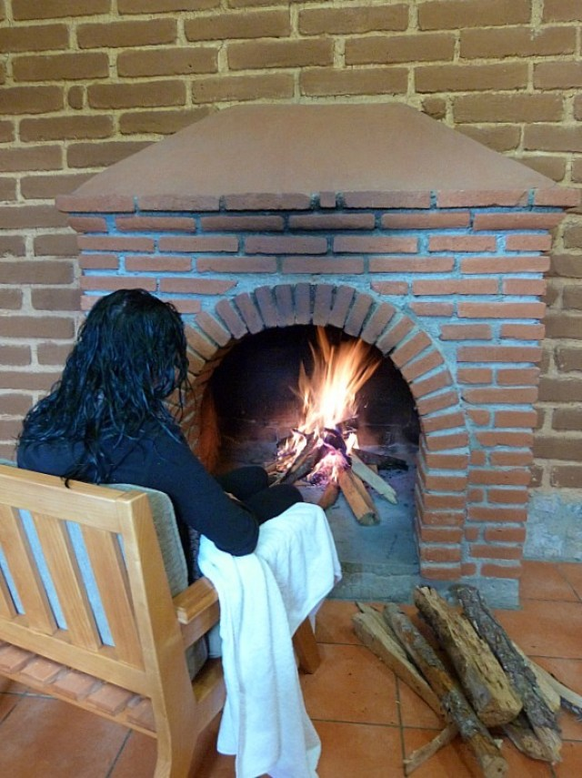 Hanging out by the fire in our eco cabin in the Pueblos Mancomunados in Mexico's Sierra Norte Mountains