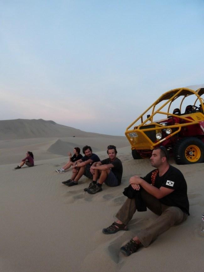 Watching the sunset in the desert around Huacachina in Peru