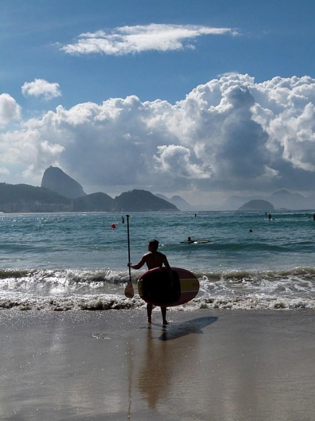 Paddleboarder on Copacabana Beach in Rio de Janeiro