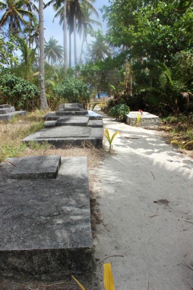 Hiking through a cemetery on Nacula Island in the Yasawa Islands of Fiji